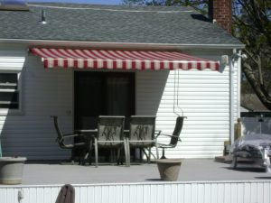 Retractable Awning installed under roof soffit
